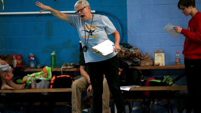 Robin Batchelor is retiring after 14 years as the boys and girls swimming coach at Tuscola.