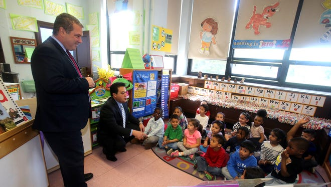 Yonkers Mayor Mike Spano and schools Superintendent Edwin Quezada speak with pre-K students during a tour of School 22 on Nepperhan Avenue. The mayor is urging the state Legislature to pass a $2 billion bond that will allow for the construction of two new schools and repairs throughout the district.