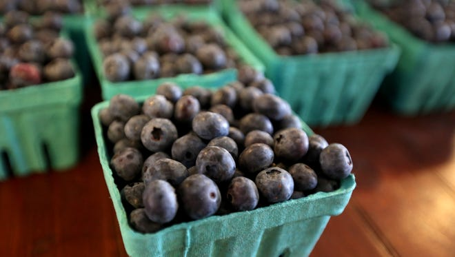 Fresh blueberries from Fordyce Farm for sale on Saturday, June 11, 2016, during the Salem Public Market's annual Strawberry Festival.