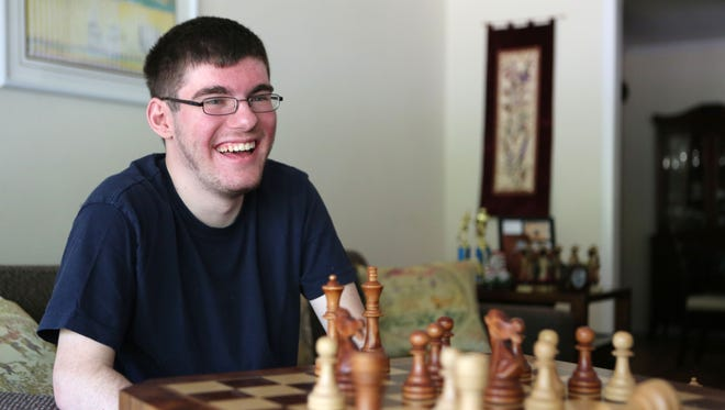 Chess player Michael Bodek, 18, of New Rochelle, one of 10 finalists in the national 2016 U.S. Junior Closed Championships, plays reporter Peter Kramer June 29, 2016 in New Rochelle. The tournament begins on July 9 in St. Louis and two of the 10 competitors come from Westchester.
