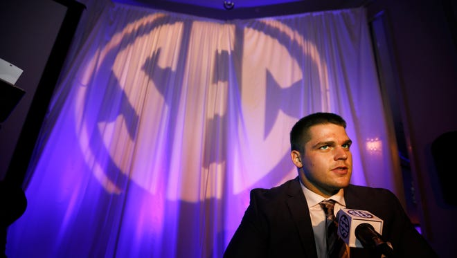 Kentucky offensive lineman Jon Toth speaks to the media at the Southeastern Conference NCAA college football media days, July 13, 2016, in Hoover, Ala.