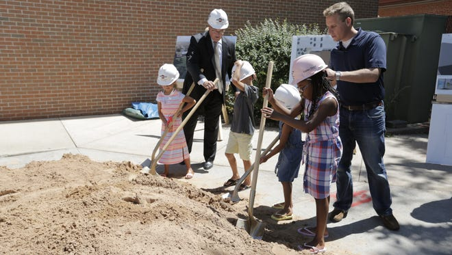 The downtown Oshkosh YMCA broke ground Friday for the new 55,000-square-foot facility being built by Miron Construction. The new facility will feature an aquatics center, a health and wellness center, group exercise studios, an indoor track, a teen center and space for community programs and new locker rooms. Construction will begin in August and is expected to be completed in fall 2017.