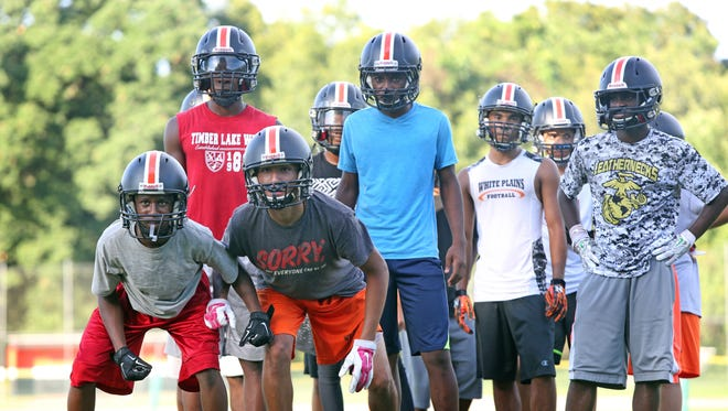 White Plains High School players work on drills during the first day of practice at White Plains High School Aug. 15, 2016.