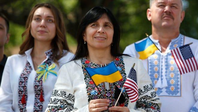 Irina Lisova of Yonkers celebrates the 25th anniversary of Ukrainian independence at St. Michael's Ukrainian Catholic Church in Yonkers on Sunday.