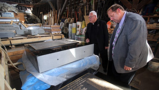 Clarkstown Supervisor George Hoehmann, right, and  Rev. David Lathrop, Clarkstown Police chaplain, examine plaques that will be part of the September 11th monument that will be installed in front of Clarkstown Town Hall during a visit to Travis Monuments in Nyack Sept. 1, 2016. The new monument will correct several mistakes, including a misspelled name, on the existing monument and will be part of a refurbished plaza in front of town hall.