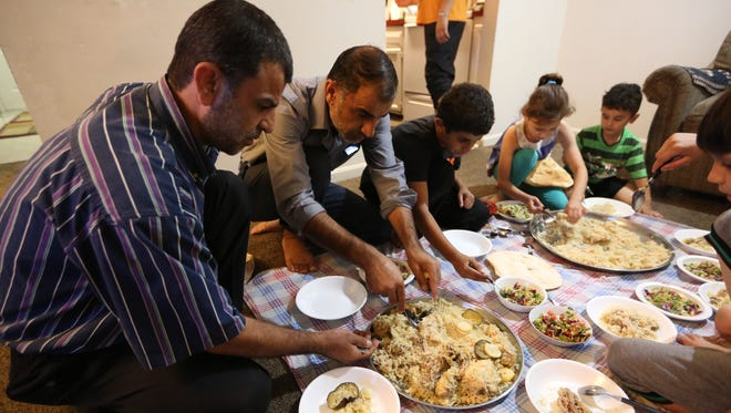A family style dinner at the apartment of Ahmad Al Tybawi
