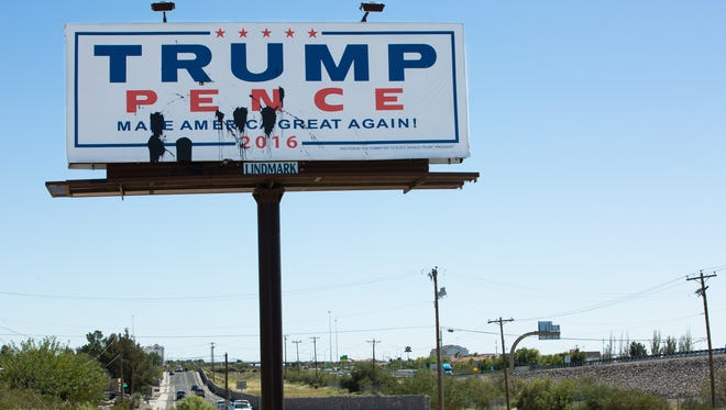 Las Cruces authorities are warning that campaign sign vandalism is a crime. This Trump-Pence billboard on Don Roser Drive, seen here on Oct. 5, 2016, was defaced with paint recently.