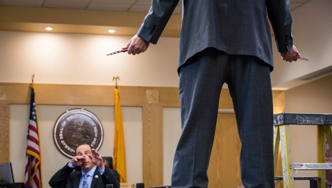 Sam Bregman, representing Keith Sandy, and Keith Sandy demonstrate the distance at which Sandy stood at the moment James Boyd was shot during his murder trial in Bernalillo County court, Monday, Oct. 5, 2016 in Albuquerque, N.M. Sandy and former Albuquerque police officer Dominique Perez are charged with the 2014 shooting death of James Boyd in March 2014.
