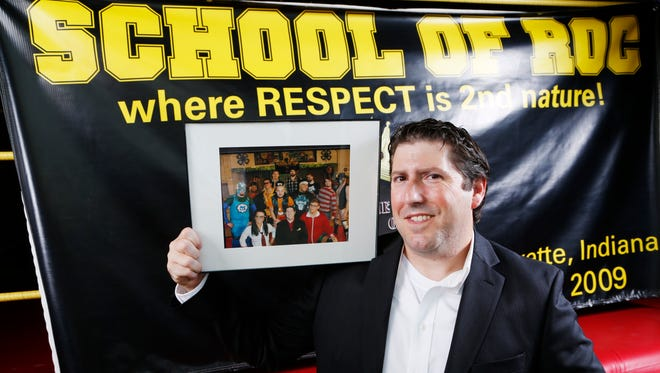 Former wrestler Billy Roc with a photo of his students of the School of Roc at his ring at 2250 Concord Road Tuesday, November 1, 2016, in Lafayette.