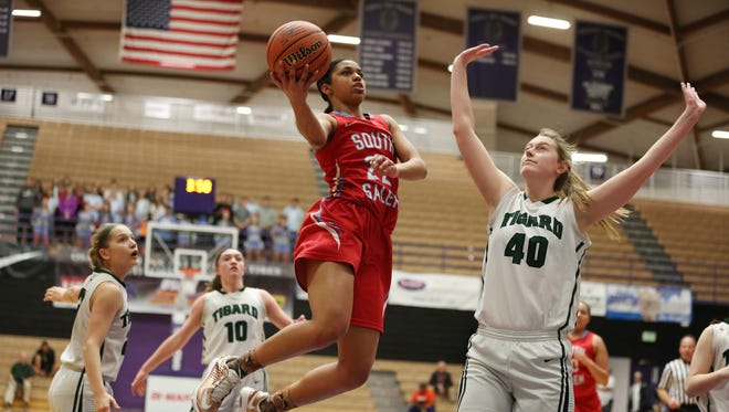 South Salem's Evina Westbrook goes up for a shot as the Saxons defeat Tigard 49-42 in the OSAA Class 6A State Championship on Saturday, March 12, 2016, at the Chiles Center at University of Portland.