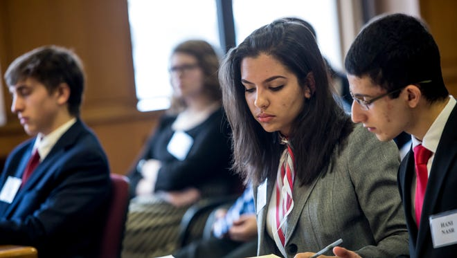 Cardinal Mooney's Adriana Mirabelli and Hani Nasr review notes during the 2017 St. Clair County Mock Trial competition.