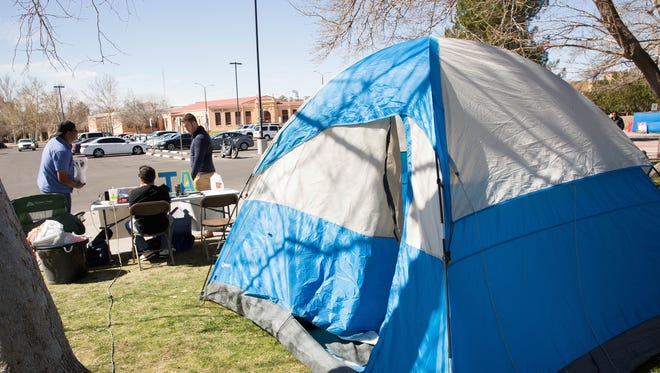 George Rivas, left, Hunter Trujillo, center and Grant Levron, right, with the Alpha Tau Omega fraternity, hang out near a tent they set up in front of Corbett Center Thursday, March 2, 2017. The fraternity is partnering with Jardín de Los Niños and members are camping as a way of putting themselves in shoes of homeless people. Jardín benefits homeless and near-homeless children.