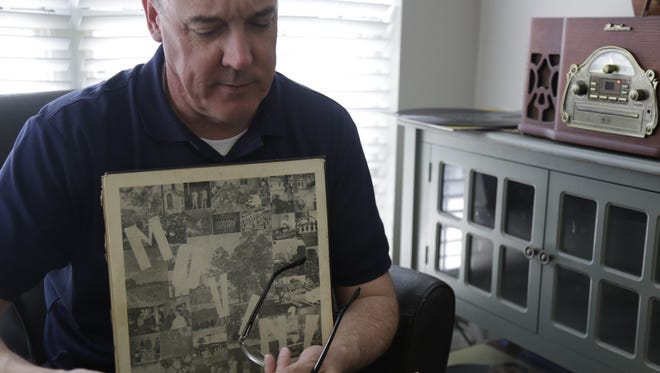 """Joe McCann sorts through a box of records he got at an auction that contained an album by the Dozier School for Boys Choir. He says he immediately knew what the record was: """"If this is what I think it is, it's creepy."""""""