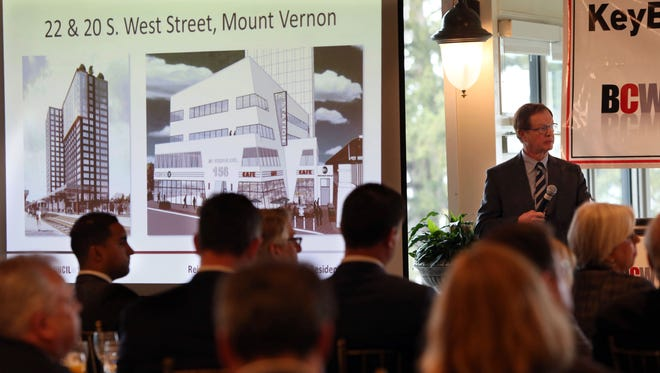"""A rendering for development in Mount Vernon is displayed as Geoff Thompson from Thompson & Bender moderates a panel called """"Reimagining our Downtowns: The New Residential Model"""" March 7, 2017 at Tappan Hill Mansion in Tarrytown. The panel, hosted by the Business Council of Westchester, featured developers building in White Plains, Yonkers, New Rochelle and Mount Vernon."""