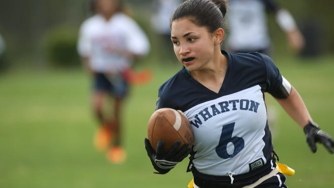 A Wharton player runs with the ball during a game against Wakulla last year in the Capital City Classic.