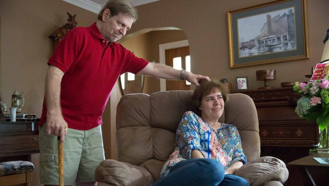 Mike Goldring scratches wife Judy Goldring's hair after she was named Mom of the Year, thanks to him submitting a letter about her unconditional loving care she bestows on their son who has C-Trigonocephaly Syndrome. May 10, 2017.
