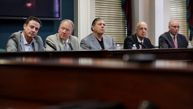 U of L basketball coach Rick Pitino, from left, interim U of L president, Dr. Greg Postel,  athletic director, Tom Jurich, consultant Chuck Smrt, and Kenny Klein answer questions during a press conference in response to the NCAA's penalties on the men's basketball program. June 15, 2017