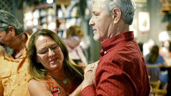 Lung transplant recipient Paul Dukor meets Joni Hennessey, the sister of his donor Tiffany Ciccarelli, when Dukor and Ciccarelli's family get together for lunch at the Tallahassee Cracker Barrel Sunday, June 25.
