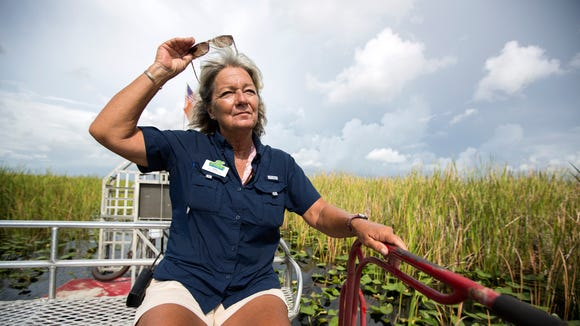 Kathy Britt prepares to put on her sunglasses while driving an airboat named Hawg at Everglades Holiday Park in Fort Lauderdale, Florida, on Friday, July 21, 2017. Britt has been driving airboats at the park for around 30 years and is currently the only female captain.
