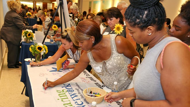 As part of the event, guests signed their name on NJ Sharing Network flags that were then flown in front of Jersey Shore University Medical Center.