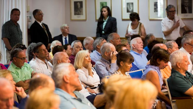Residents fill the Naples City Council Chamber during a public meeting Tuesday, Aug. 15, 2017, held by the Naples Community Redevelopment Agency to discuss the potential acquisition of land to be used for a parking garage downtown. The garage would replace the parking lot along the intersection of Fourth Avenue South and Fourth Street South. Money slotted for the project is upwards of $16 million.