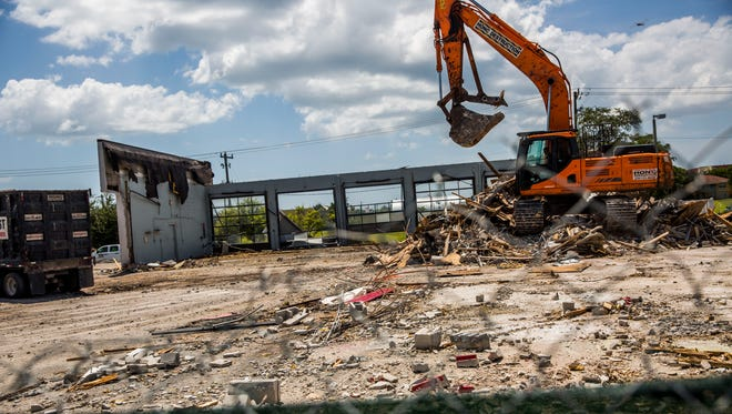 Demolition begins on 2 acres next to the Neighborhood Health Clinic on Monday, Aug. 21, 2017, in Naples in preparation for expansion. Architectural plans are completed to build an expansion on some of the site for the clinic at 121 Goodlette-Frank Road.