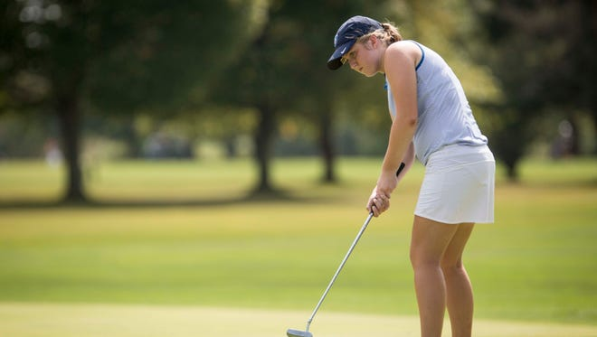 Delta's Sarah McDowell putts along the green Sept. 16 at Crestview Golf Course during the Delaware County Girls Golf Sectional.