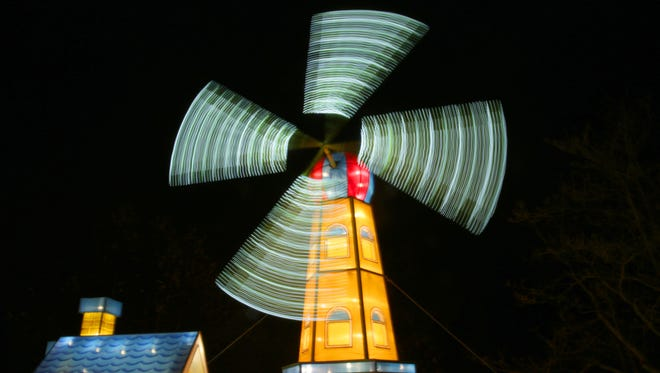 "A long-exposure shot shows the blur of a windmill at ""China Lights"" at Boerner Botanical Gardens in Whitnall Park in 2016. The 2017 edition of ""China Lights"" runs from Sept. 22 through Oct. 22."