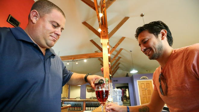 Benjamin Maier, Amaro Winery owner and wine maker, pours a glass of Las Cruces Sunrise for Damien Luna of Las Cruces.