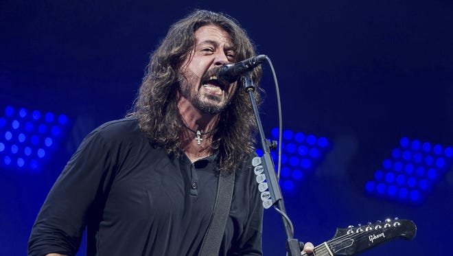 Singer Dave Grohl performs with Foo Fighters at the 2017 Glastonbury Festival.