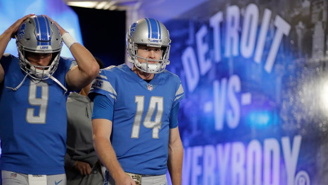 Lions quarterbacks Matthew Stafford (9) and Jake Rudock walk to the field prior to the game against the Browns at Ford Field on Sunday, Nov. 12, 2017 in Detroit.