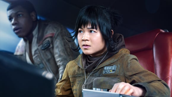 Kelly Marie Tran as Rose and John Boyega as Finn in