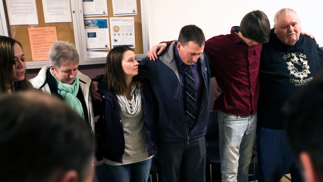 Kyle Keding joins friends and family in the Serenity Prayer, which is commonly used in Narcotics Anonymous meetings, inside the Wood County Courthouse before his sentencing in Wisconsin Rapids, Wis., Monday, February 5, 2018.