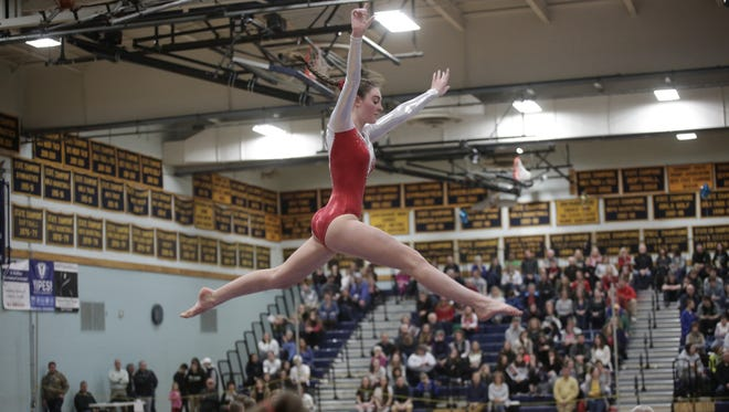 Lexie Cody competes on beam during Saturday's Vermont state gymnastics state championships.