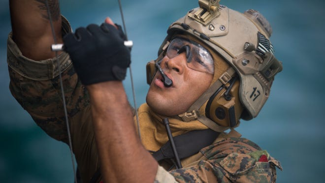 A Force Reconnaissance Marine with Maritime Raid Force, 31st Marine Expeditionary Unit, climbs a caving a ladder in Guam, January 26, 2018, during Visit Board Search and Seizure training. VBSS teaches Marines how to take over ships for searches and counter-piracy operations.  As the Marine Corps' only continuously forward-deployed MEU, the 31st MEU provides a flexible force ready to perform a wide range of military operations.