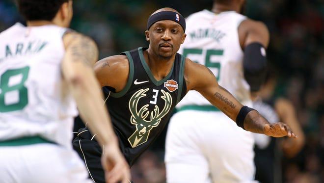 Bucks guard Jason Terry guards Celtics guard Shane Larkin.