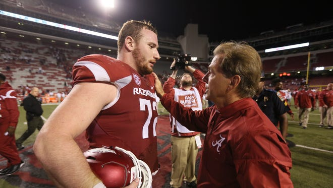 Oct 8, 2016; Fayetteville, AR, USA; Alabama head coach Nick Saban offers his condolences to Arkansas center Frank Ragnow for the loss of Ragnow's father, after the game at Donald W. Reynolds Razorback Stadium. Alabama defeated Arkansas 49-30.