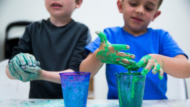 Students play with their newly made slime on June 20, 2017, during a summer camp at the Center for Performing Arts Bonita Springs.