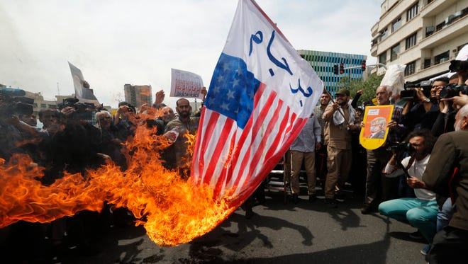 Iranians burn U.S. flags during an anti-American protest after weekly Friday prayer ceremony in Tehran, Iran, May 11, 2018. Iranians gathered to protest against the U.S. and President Trump after his withdrawal from a 2015 nuclear deal. Trump on May 8, announced the U.S. withdrawal from the deal on May 8.