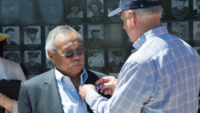 Frank Mantua, left, receives the Silver Star and Oak Leaf Clusters Bronze, from U.S. Rep. Steve Pearce, R-N.M., Friday May 25, 2018 at Veterans Memorial Park. Mantua was awarded the medals for gallantry in action while serving as a platoon leader during the battle of Tuy Hoa in Vietnam in 1968.