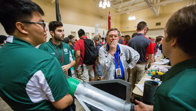 Randy Marek, center, a flight safety reviewer at the Spaceport America Cup talks with the competition team from California State Polytechnic University, Tuesday June 19, 2018 at the Las Cruces Convention Center.