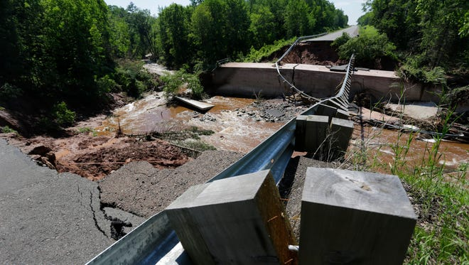 The bridge along U.S. 2 between Tomich Road and Bayfield County G near Keystone Township in Bayfield County is washed out by North Fish Creek Monday, June 18, 2018.