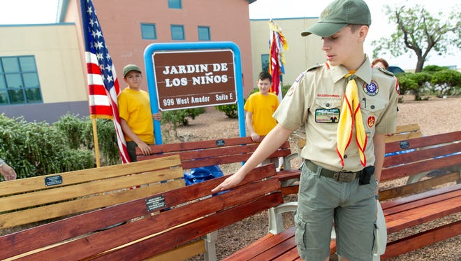 Eagle Scout candidate Evan Taylor dedicates five benches to Jardín de los Niños for his Eagle Scout project on Saturday, July 28, 2018. Taylor and the Boy Scouts of America Troop 180 made the benches. The project took over 130 hours to complete.
