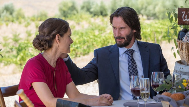 """Lindsay (Winona Ryder) and Frank (Keanu Reeves) are paired off in """"Destination Wedding."""""""