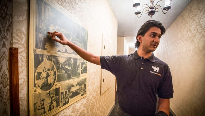 Raj Patel, Corporate Director of Development for Hawkeye Hotels in the Hotel Fort Des Moines convention level with historical photos, Monday Feb. 2, 2015, in Des Moines, Iowa.