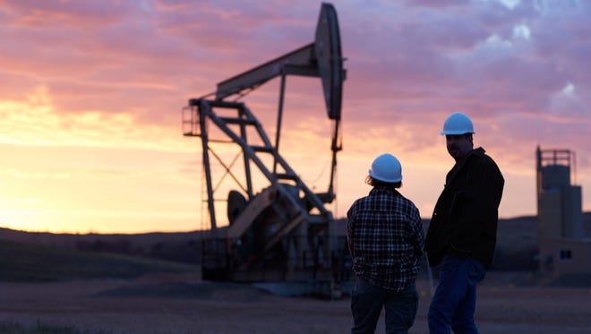 """A sunrise at an oil well in the Bakken is shown. """"Boomtowners"""" focuses on some longtime residents and newcomers in the Sidney and Williston, N.D., areas whose residents work in the oil fields or are impacted by the oil boom."""