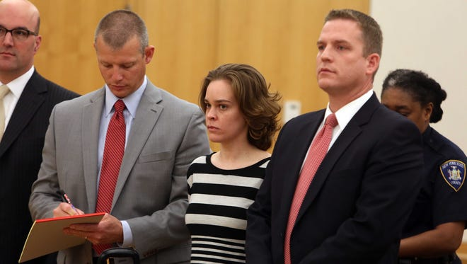 Lacey Spears and her lawyers attend a brief hearing Wednesday in Westchester County Court in White Plains.