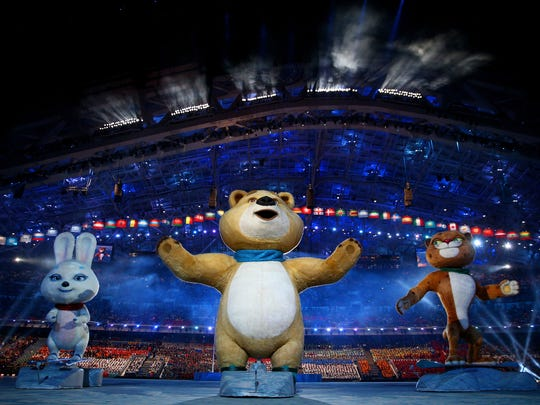 Olympic mascots the Hare, the Polar Bear and the Leopard wave during the Opening Ceremony.