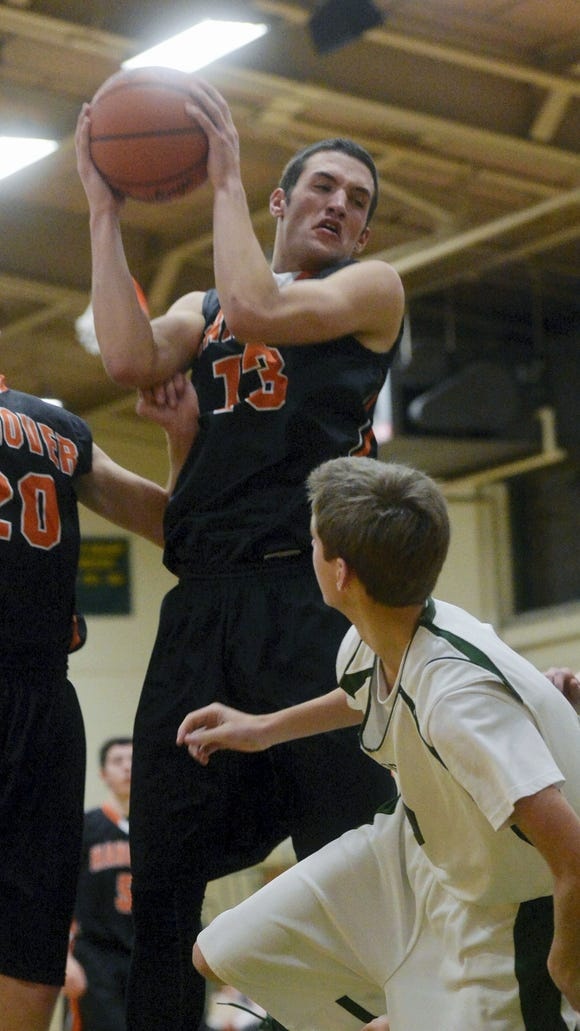 Hanover's Dylan Krieger (13) gets the rebound against York Catholic's Andrew Forjan in the second half of a boys basketball game on Friday, Dec. 19, 2014, at York Catholic. Hanover defeated York Catholic 62-43. (CHRIS DUNN -- GAMETIMEPA.COM)