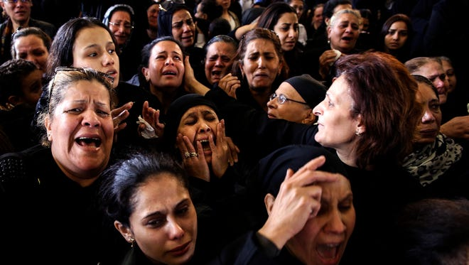 Women cry during the funeral for those killed in a Palm Sunday church attack in Alexandria, Egypt, at the Mar Amina church on April 10, 2017.